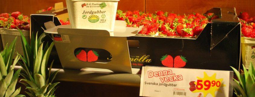 exponeringsställ och exponeringshylla med jordhubbar